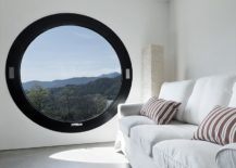 Pure-and-clean-white-room-with-a-dark-round-window-217x155