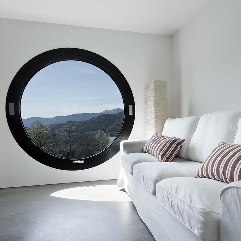 Pure and clean white room with a dark round window