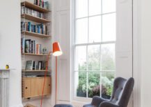 Reading-nook-with-a-dynamic-reading-chair-and-contemporary-lamp--217x155