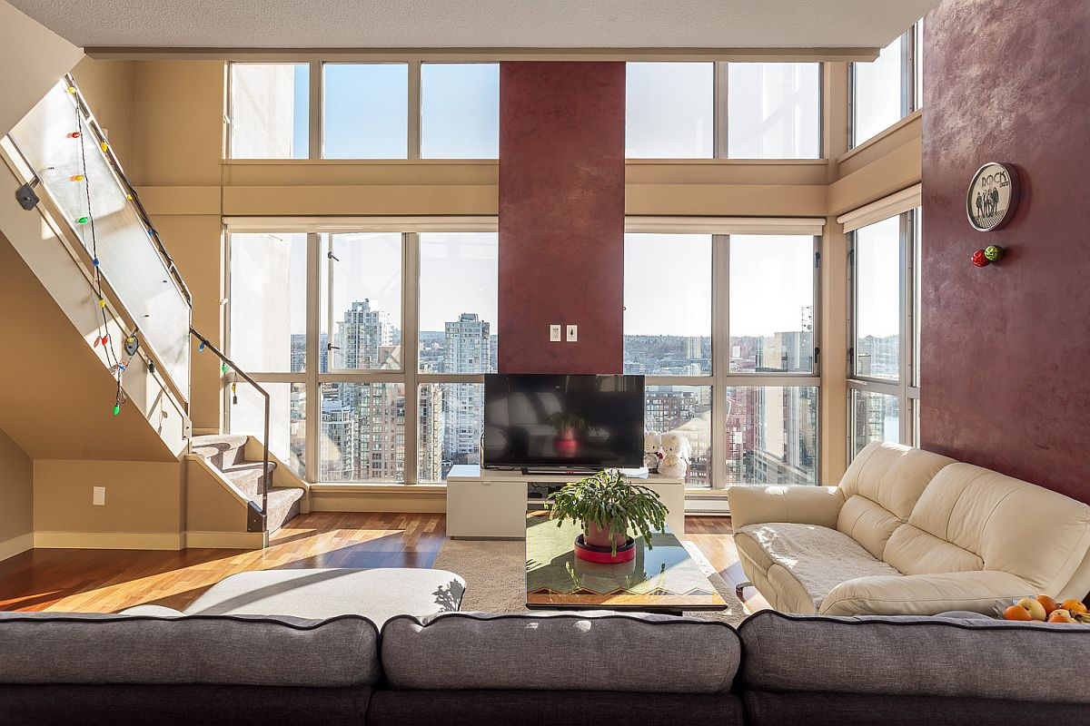 Red adds glamor to the large loft living room Urbane Vancouver Loft Merges Remarkable Views with Refined Living