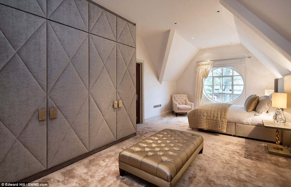 Round window softens a glamorous bedroom