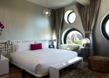 Round-windows-are-perfect-for-a-modern-bedroom--217x155