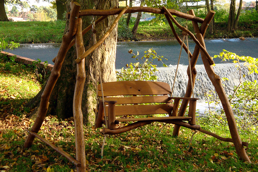 Rustic garden swing for a country backyard