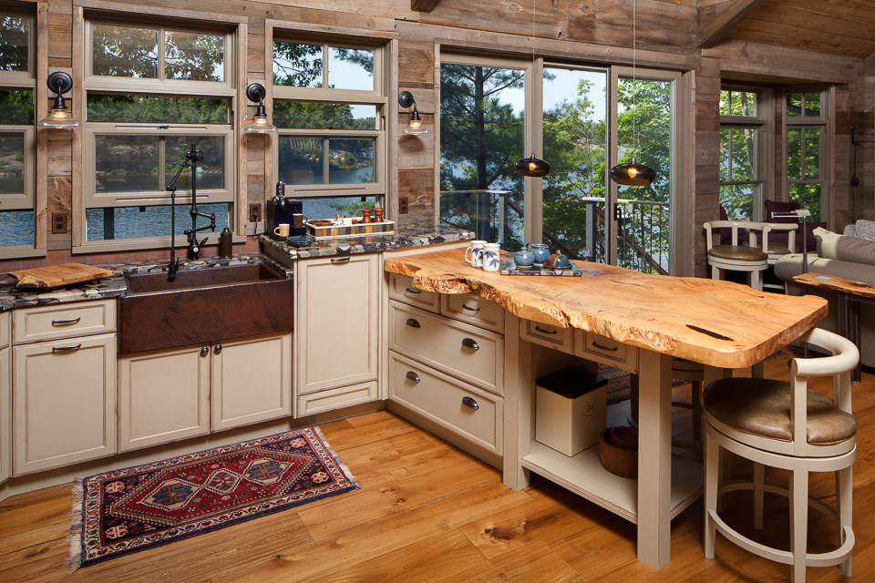 Rustic-kitchen-with-a-pale-raw-edge-wooden-countertop