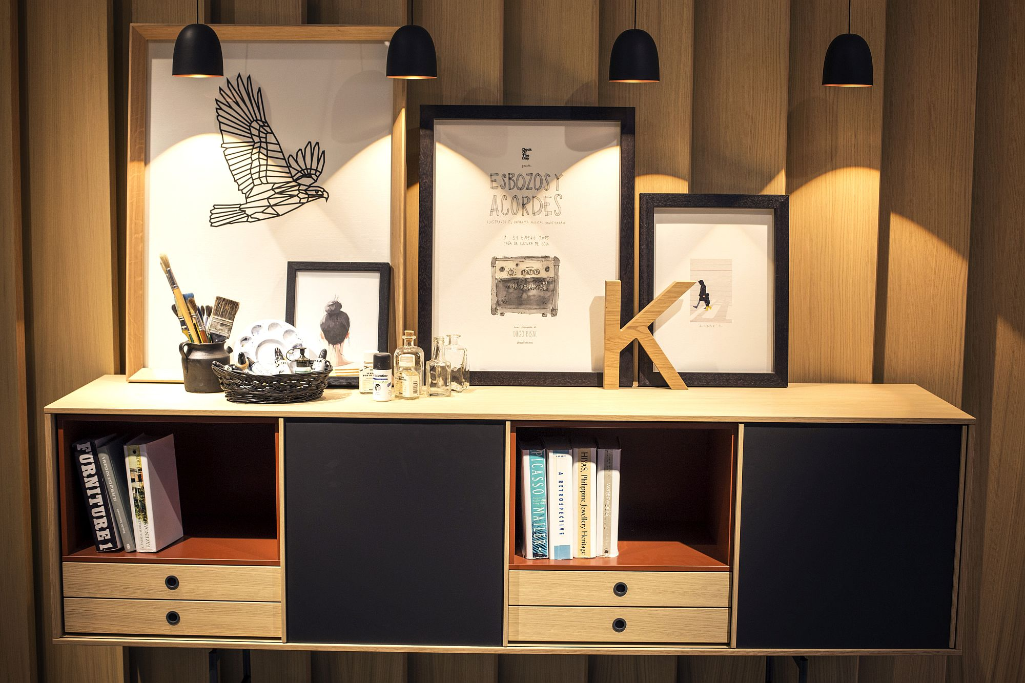 SIdeboard-and-casually-placed-art-pieces-illuminated-beautifully-Treku
