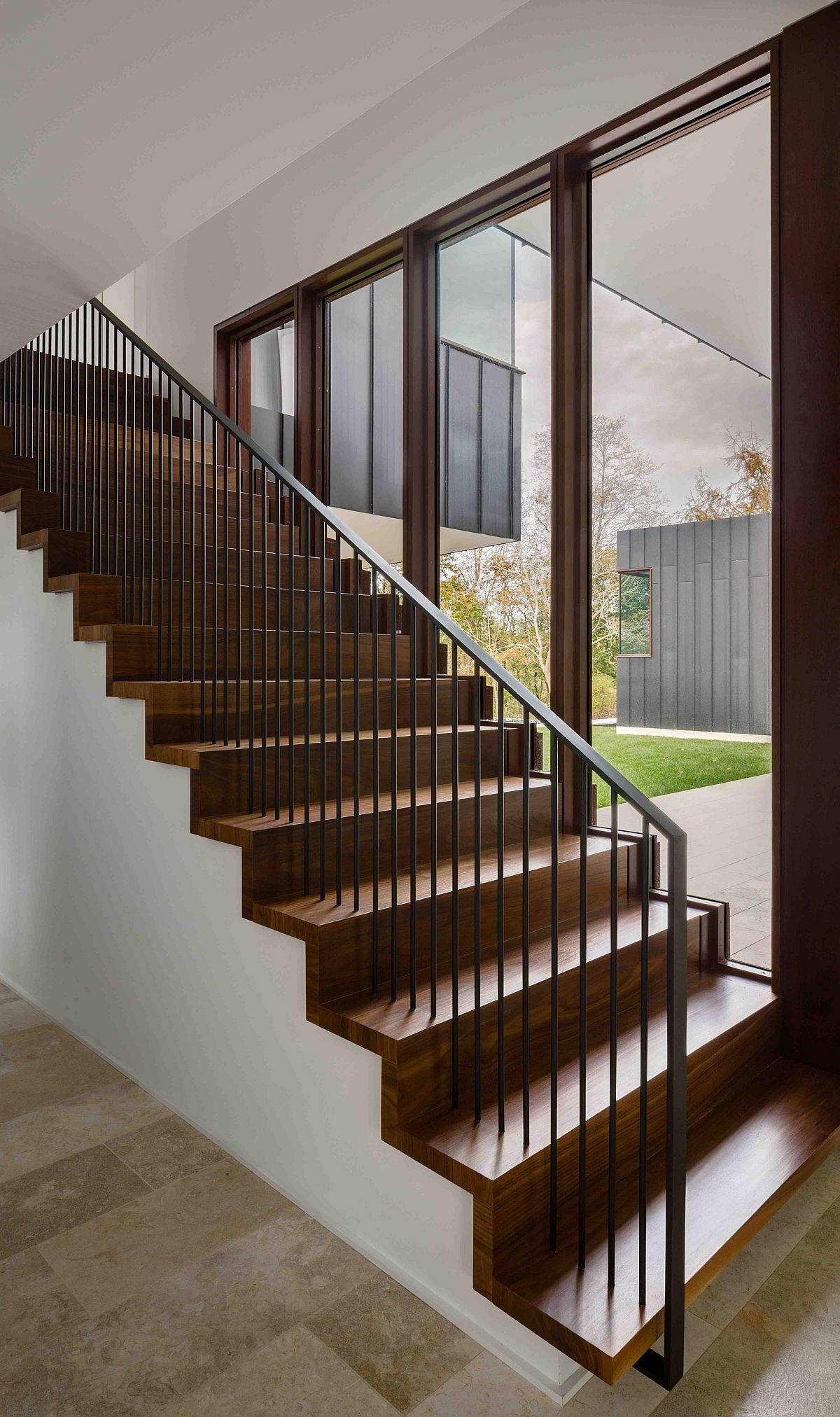 Simple wooden staircase with large glass doors