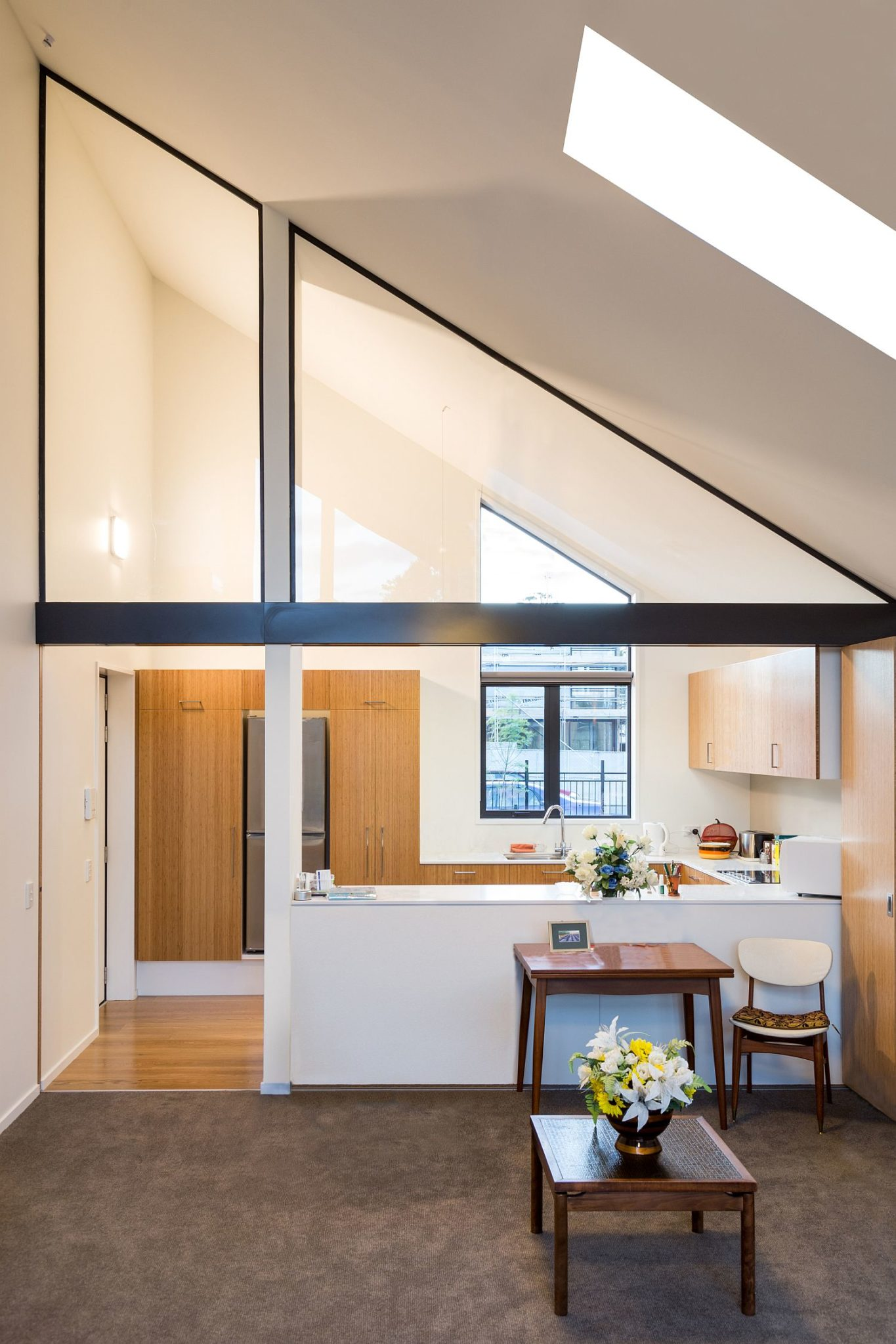 Slanted roof and skylights shape a unique interior