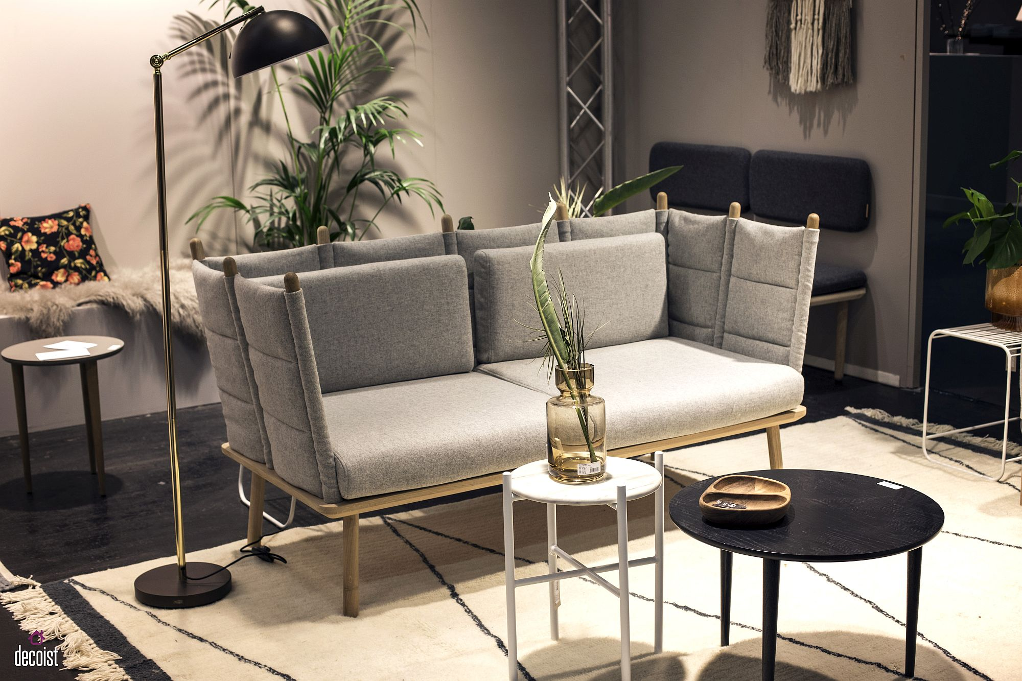 Slim floor lamp next to comfy counch with ample seating