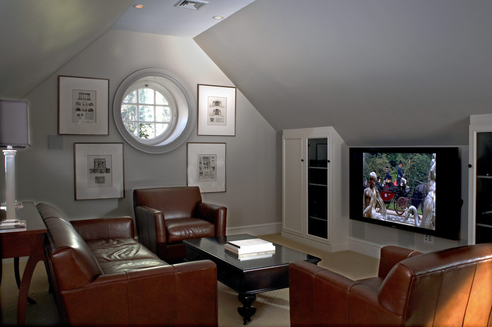 Small round window in a dim and cozy living room