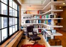 Smart-shelving-creates-a-room-within-a-room-along-with-shelf-space-for-books-217x155