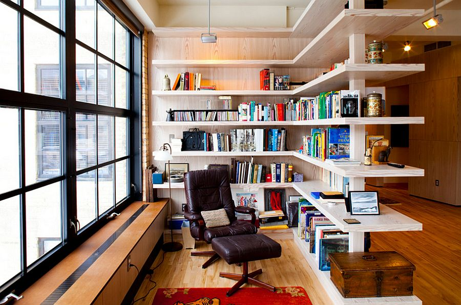 Smart shelving creates a room within a room along with shelf space for books