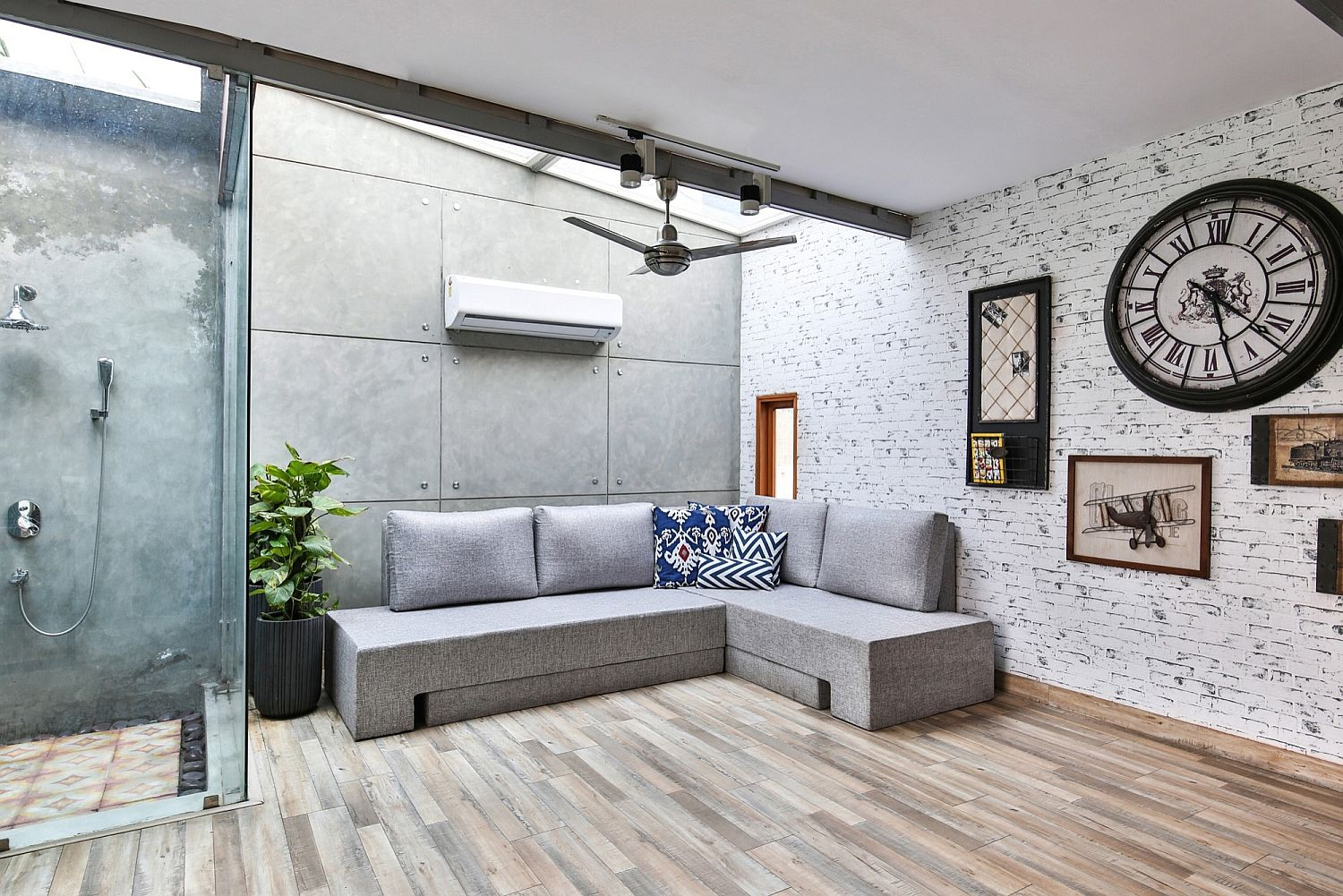 Sofa doubles as daybed in the office and recreational space Mixing Work and Play: Multi Purpose Studio on Terrace with Modular Ease