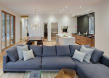 Spacious-and-open-living-area-with-a-large-blue-sectional-217x155
