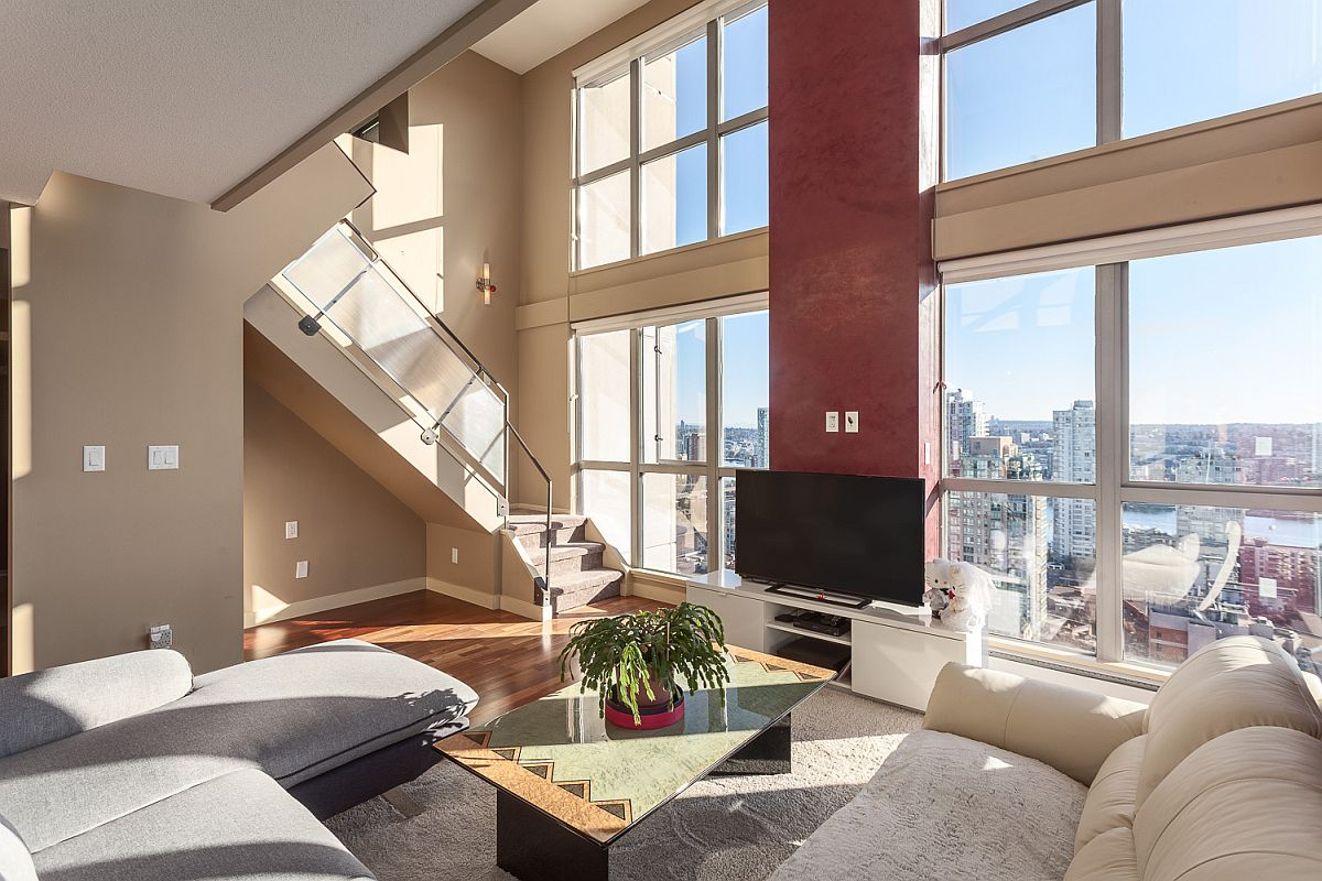 Spacious living room of the loft with a view of Downtown Vancouver