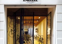 Steel fence separates the shop from the street 217x155 Bullit Cyclery: Dark Bike Shop in Valencia Gets a Breezy, Cozy Revamp