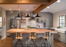 Stylish-townhouse-kitchen-in-gray-and-white-with-a-wooden-countertop-for-the-island-217x155