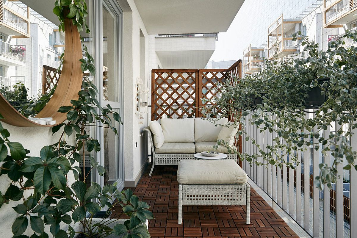 Terrace of the small apartment with wicker decor and greenery