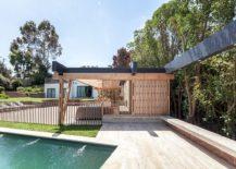 Timber-framework-keeps-out-harsh-sunlight-along-with-sliding-doors-217x155
