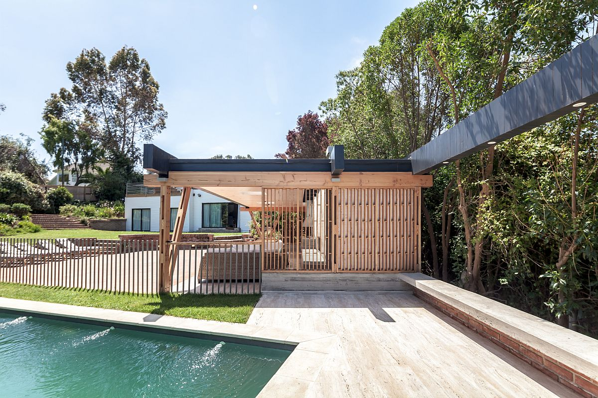 Timber framework keeps out harsh sunlight along with sliding doors