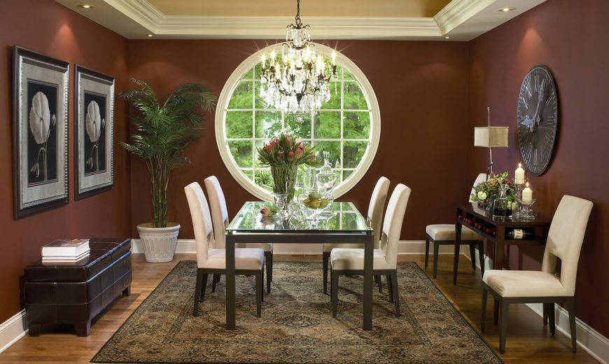 Traditional dining room with a large round window