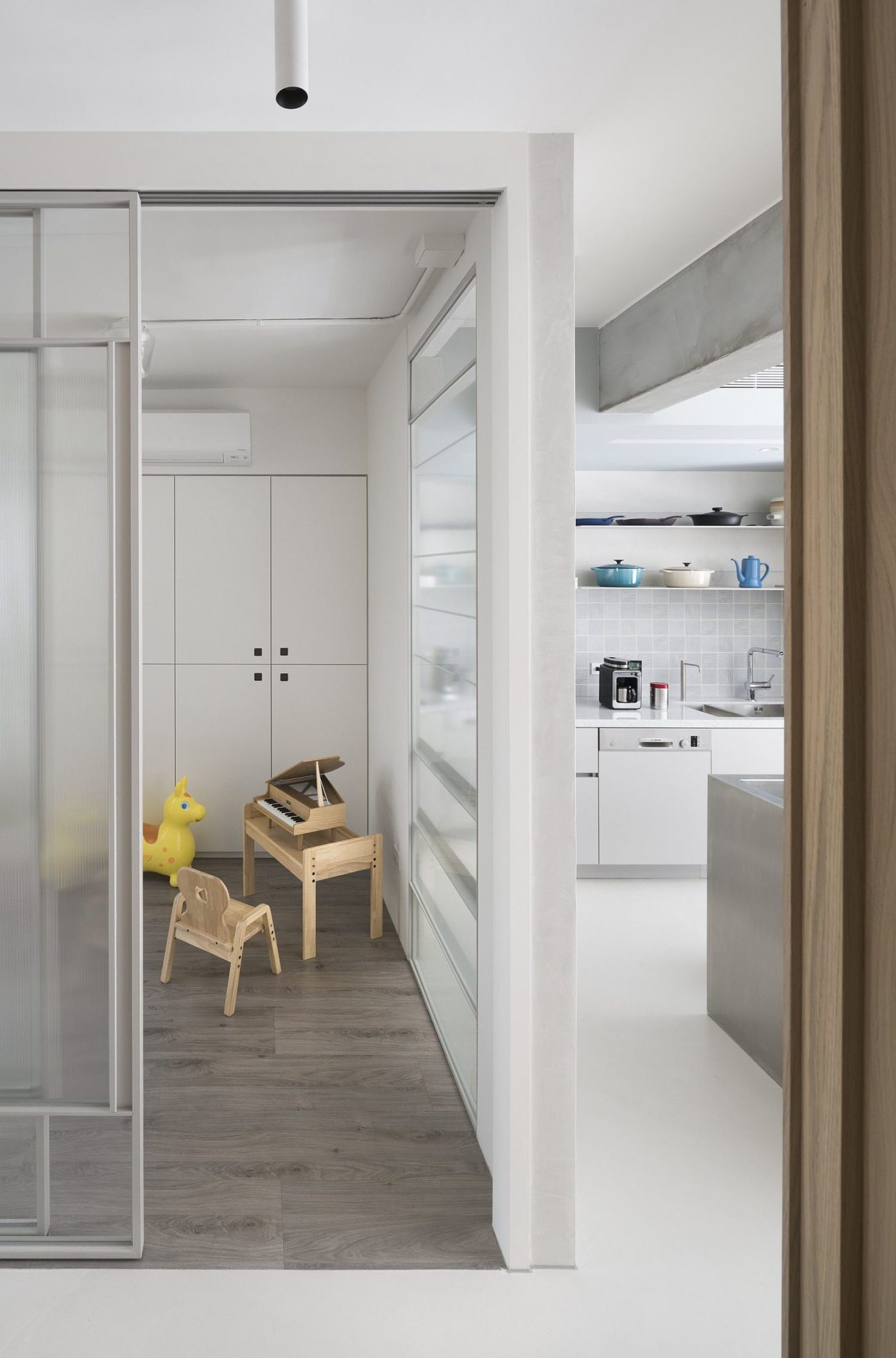 This space savvy taipei apartment does away with for Sliding glass walls