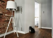 Tripod floor lamp in white for the living room corner 217x155 Renovated Krakow Apartment Showcases Beauty of Exposed Brick Walls