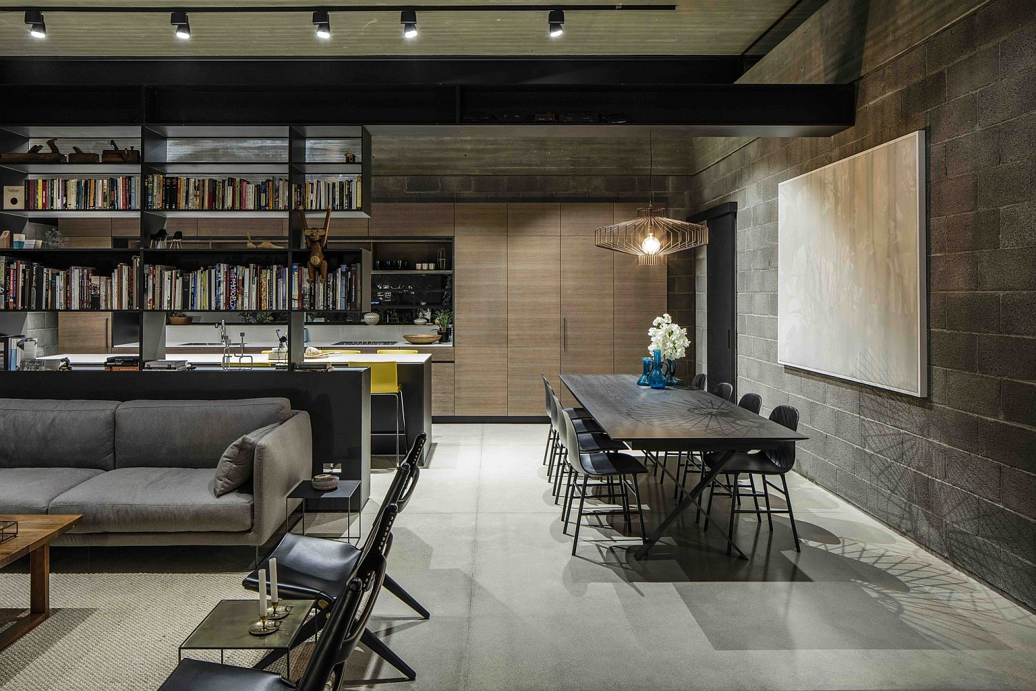 Two-sided library separates the lounge from the kitchen