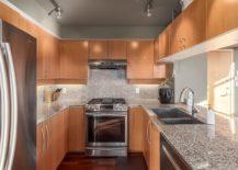 U-shaped-modern-kitchen-deisgn-with-wooden-cabinets-217x155