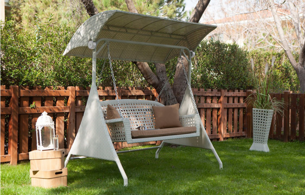 Unique-white-swing-with-a-compelling-design-and-brown-cushions