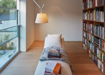 Upper-level-home-library-with-relaxing-lounger-217x155