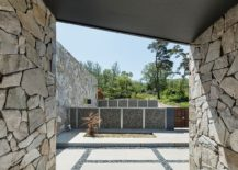 View of the entrance and the landscape from the Layers 217x155 The Layers: Serene Rustic Retreat with Stone Walls Blends into the Landscape