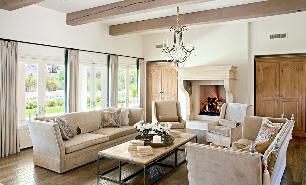 Visible beams and defining beige interior in a cozy living room