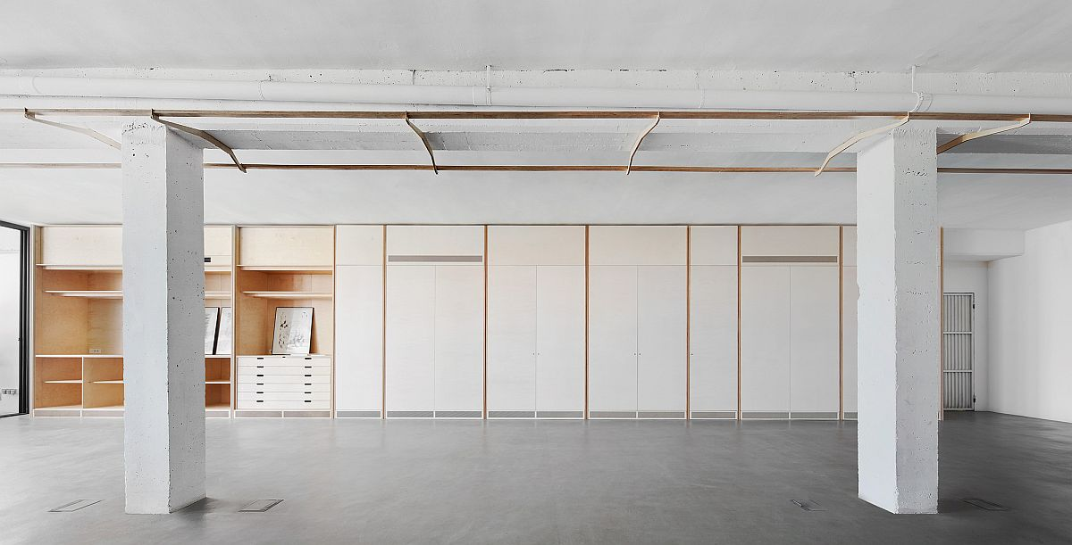 Wall of timber shelves can be easily hidden when not in use