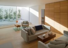 Wall-of-wood-also-offers-additional-storage-space-217x155