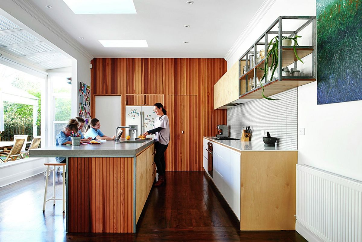 Western Red Cedar lining boards create a cozy, open kitchen