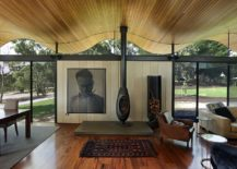 Wood-glass-and-metal-shape-the-open-living-room-217x155