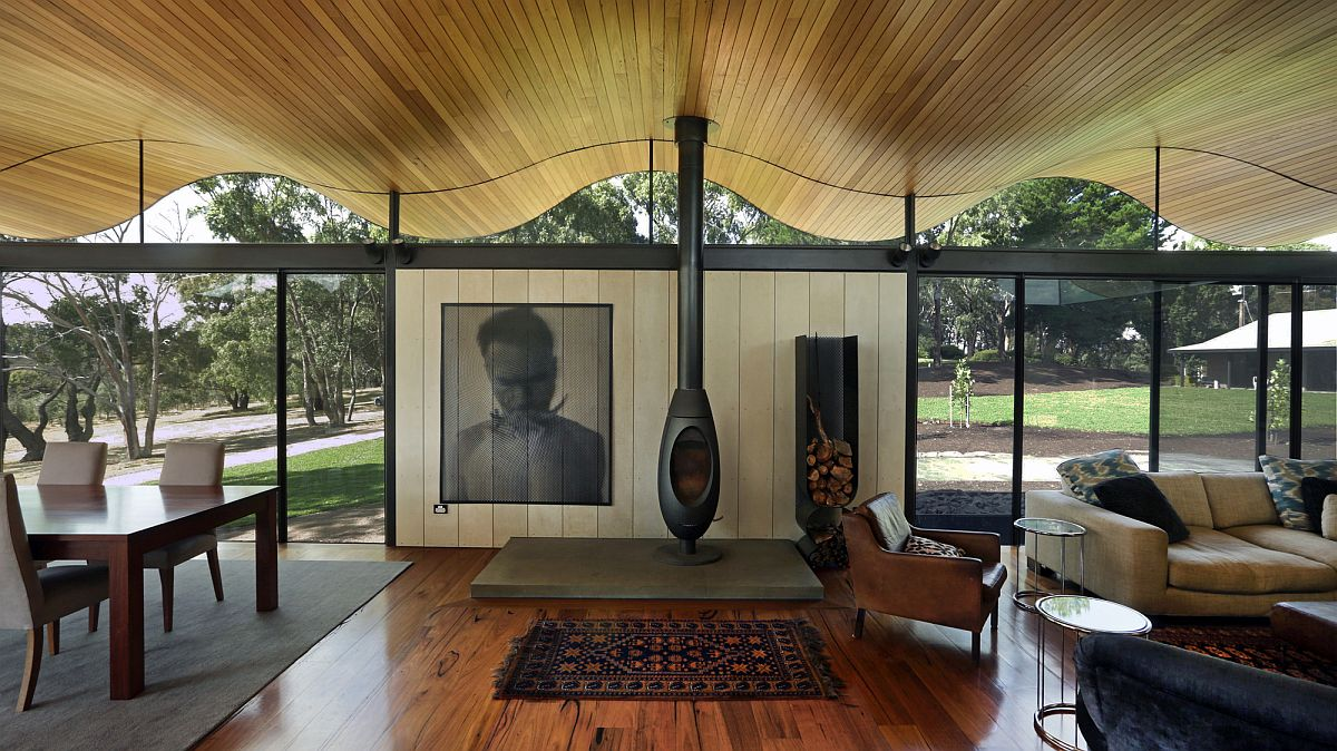 Wood-glass-and-metal-shape-the-open-living-room