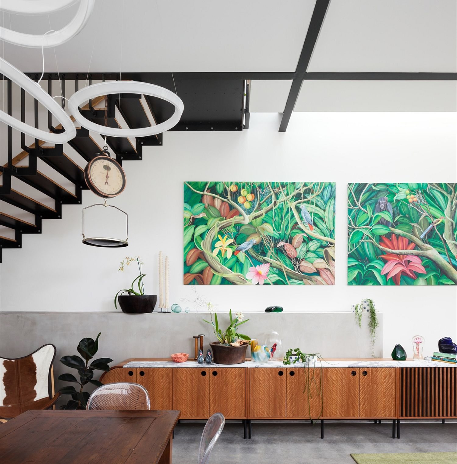 Wooden decor and bright wall paintings in the living space
