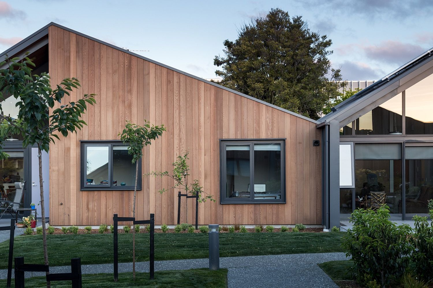 Wooden exterior and striking gabled frame of the Mary Potter Apartments