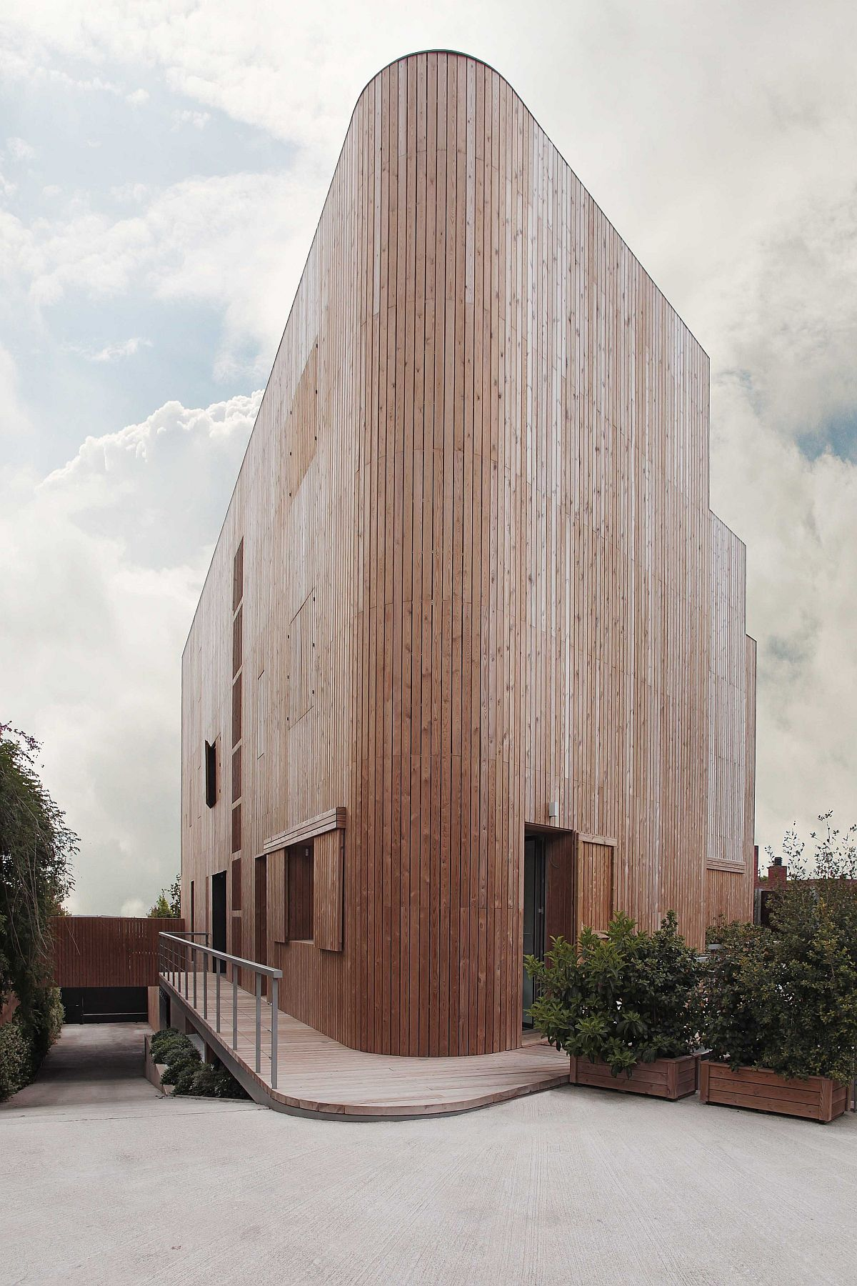 Wooden facade custom designed to keep out street noise and pollution