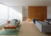Wooden-flooring-and-partition-gives-the-interior-a-cozy-modern-appeal-217x155