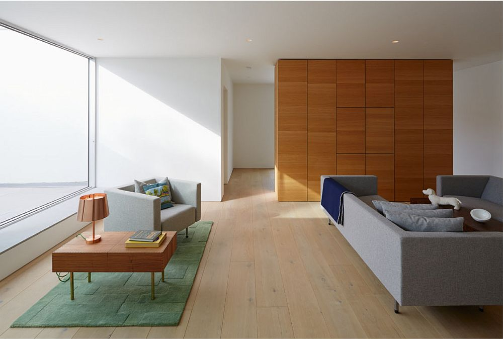 Wooden flooring and partition gives the interior a cozy modern appeal