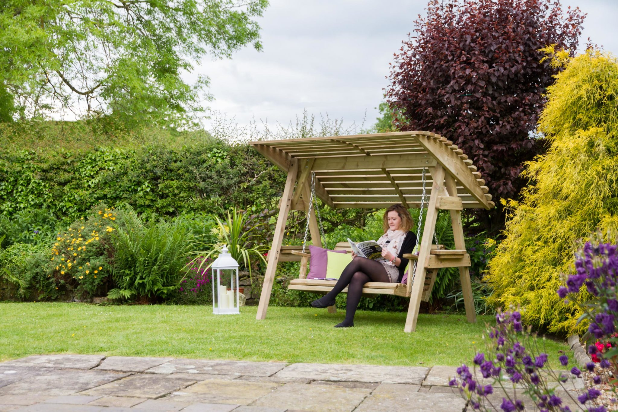 Wooden-garden-swing-with-a-wide-canopy-