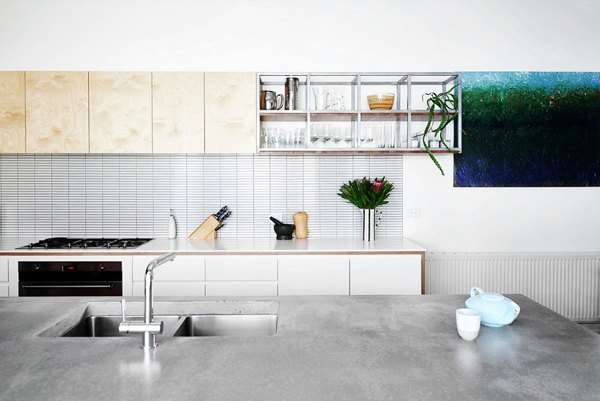 Wooden shelf above the kitchen counter is a space-savvy addition