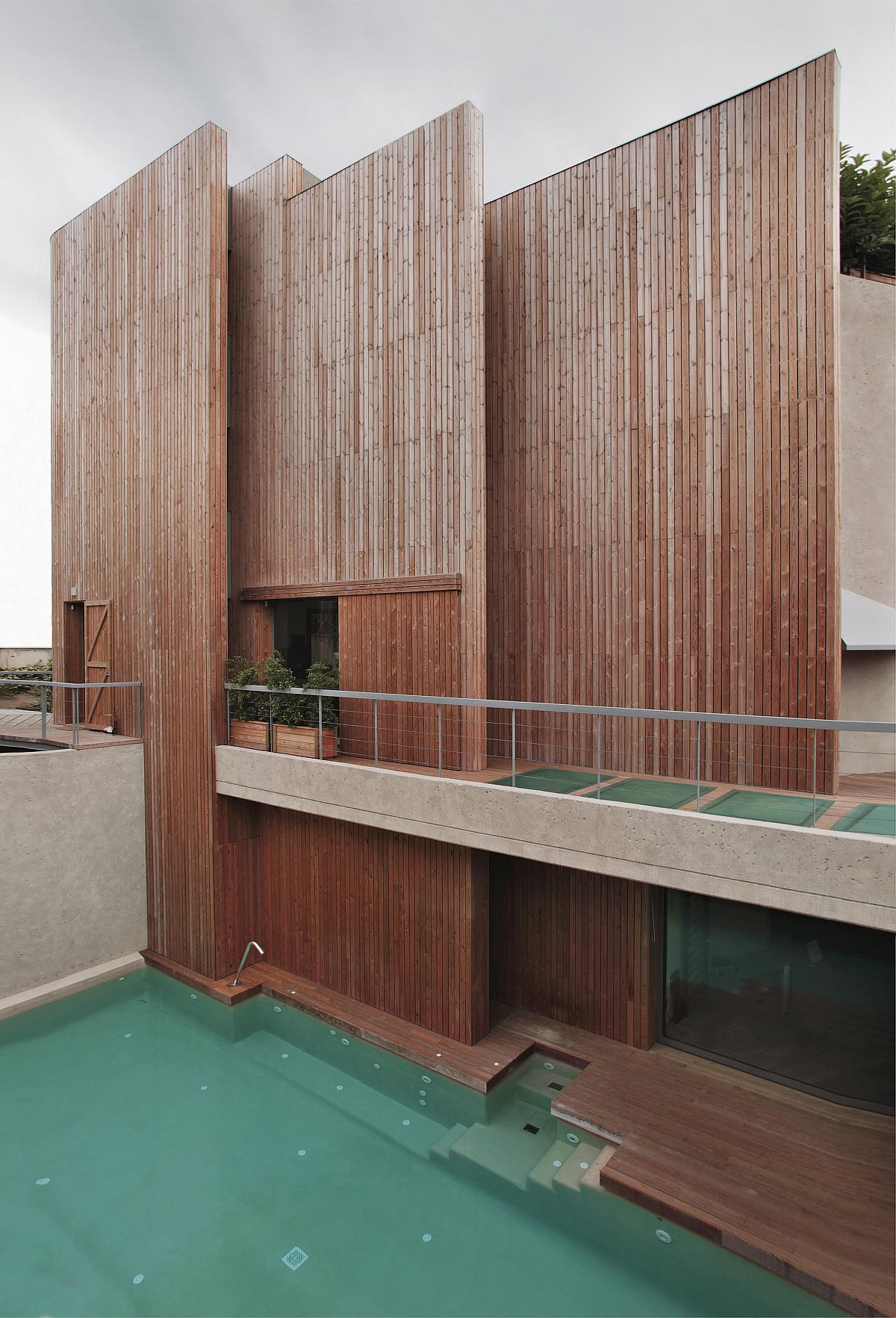 Wooden slats create a smart and bespoke facade that gives the Barcelona home a distinct look