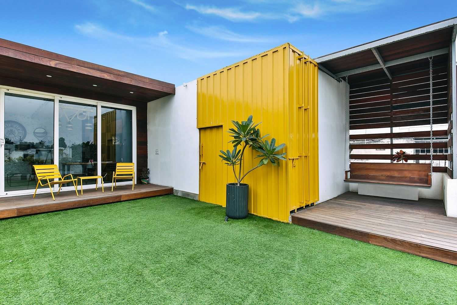 Yellow adds a sense of color and style to the terrace addition