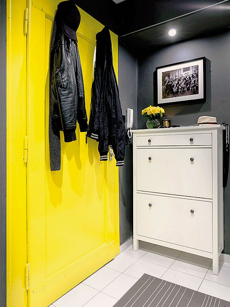 Yellow coupled with gray elegantly inside the small apartment