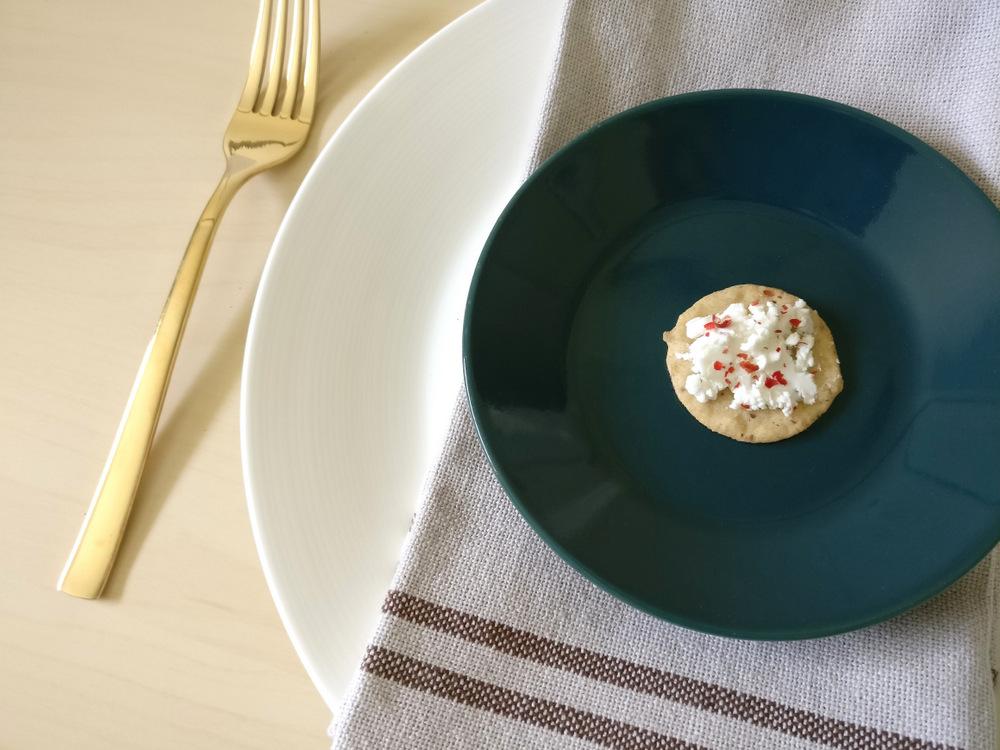 A linen napkin offsets a teal plate