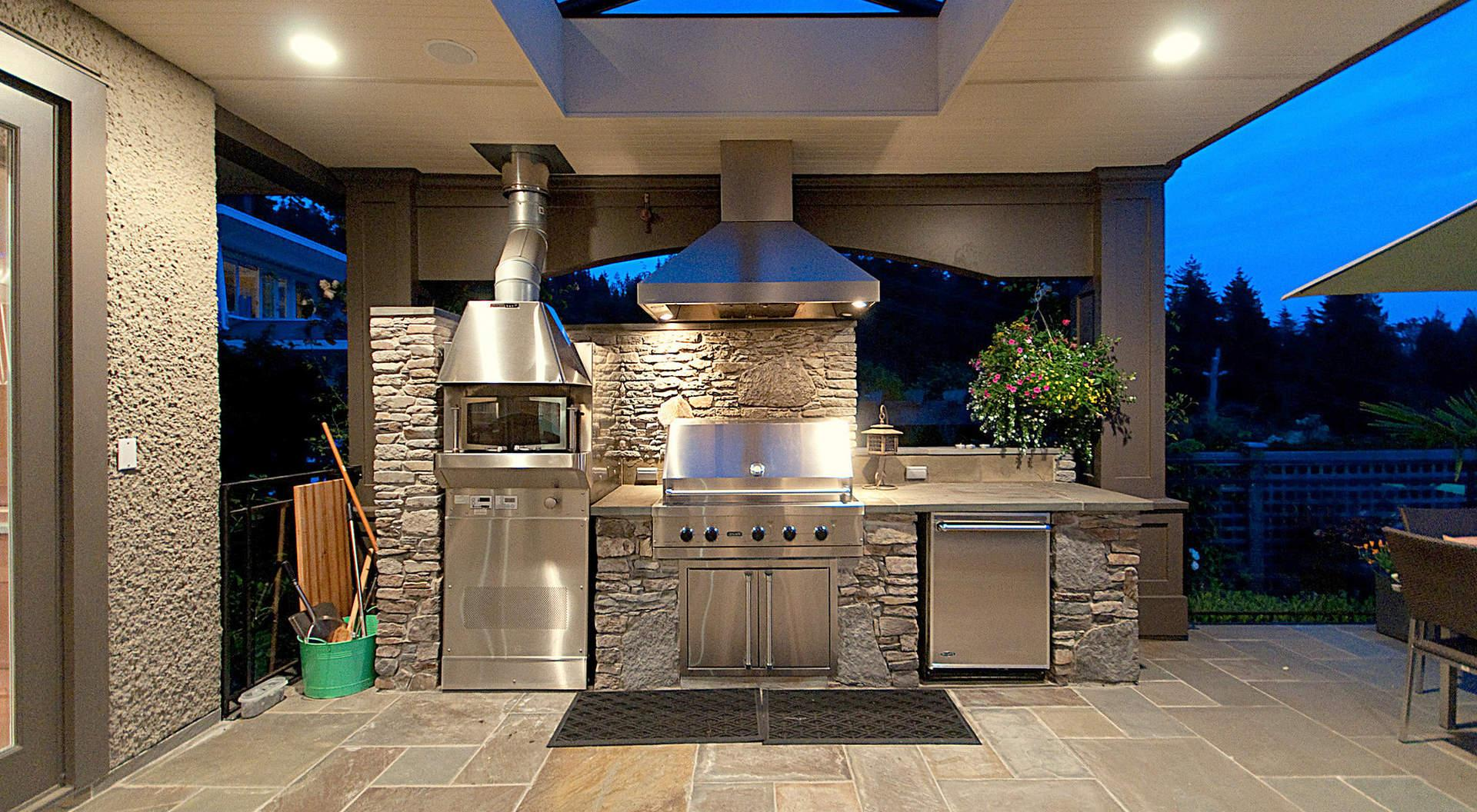 A marvelous small stone outdoor kitchen