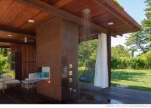 A-subtle-outdoor-shower-that-hides-itself-in-the-sleek-wooden-decor-217x155
